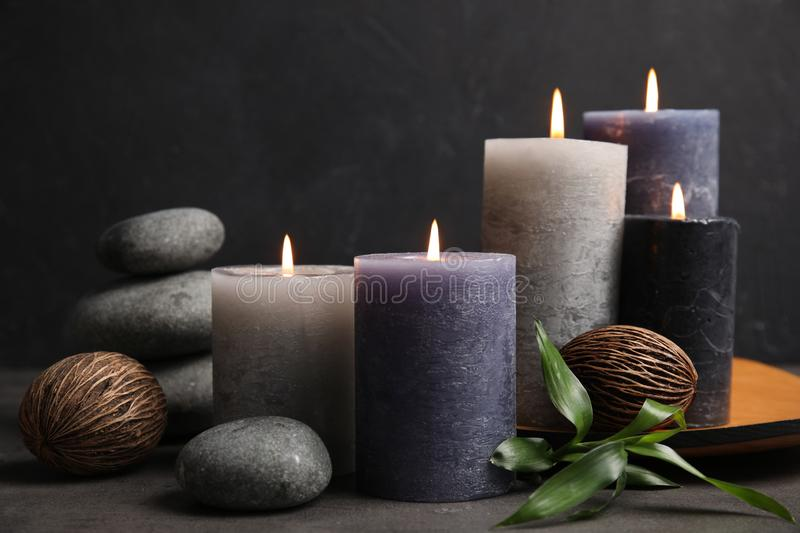 Spa composition with burning candles. On table royalty free stock images