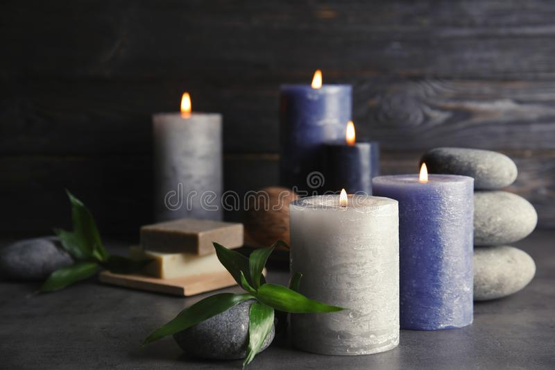 Spa composition with burning candles on table. Space for text stock photo
