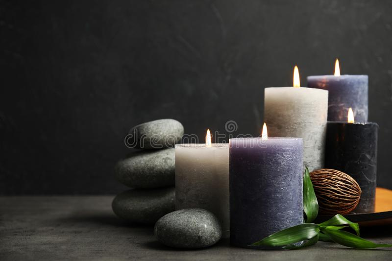 Spa composition with burning candles on table. Space for text stock photography