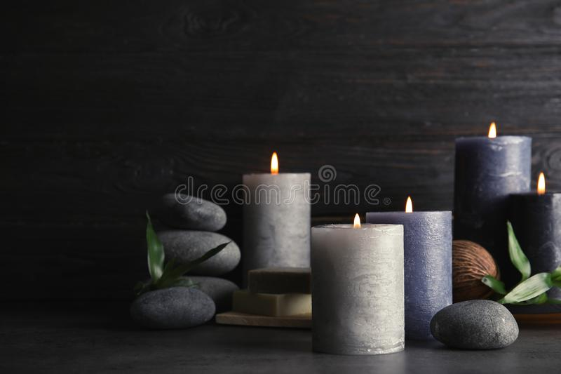 Spa composition with burning candles on table. Space for text royalty free stock images