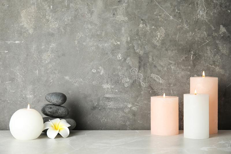 Spa composition with burning candles on table. Space for text royalty free stock image
