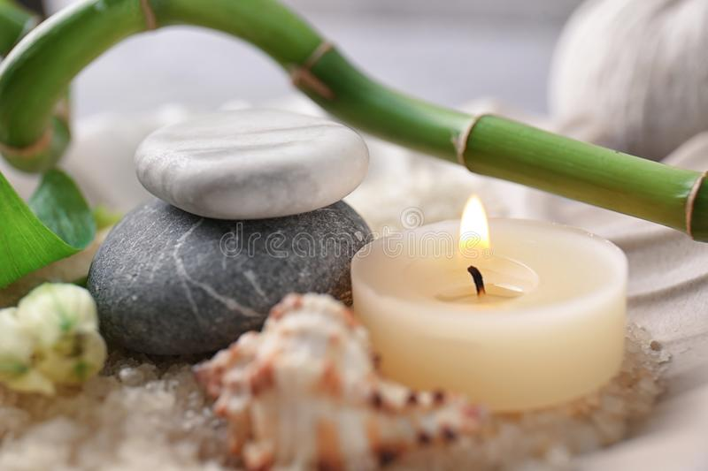 Spa composition with candle and stones, closeup stock images