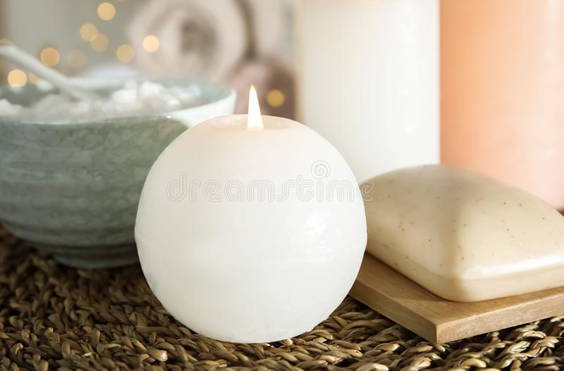 Spa composition with candle on wicker mat. Closeup royalty free stock photography