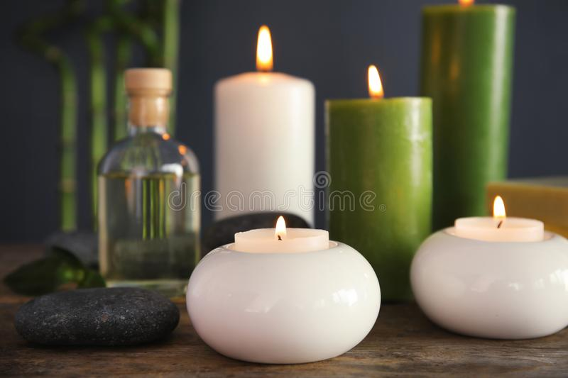 Spa composition with candles and cosmetic. On table royalty free stock photo