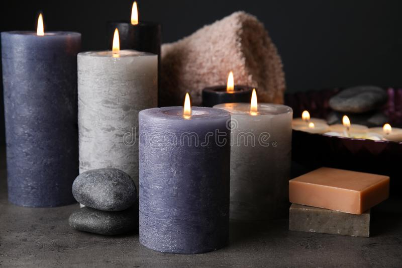 Spa composition with candles and cosmetic. On table royalty free stock image
