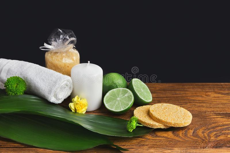 Spa composition with lime, towel and candle royalty free stock images