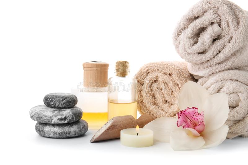 Spa composition with rolled towels and stones on white background royalty free stock images
