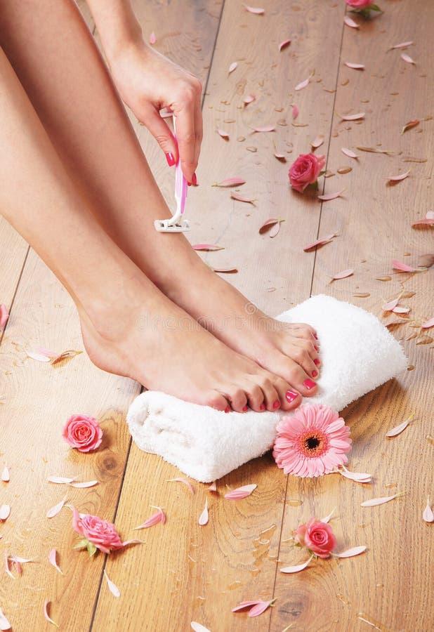 A spa composition of shaving feet and petals stock photos