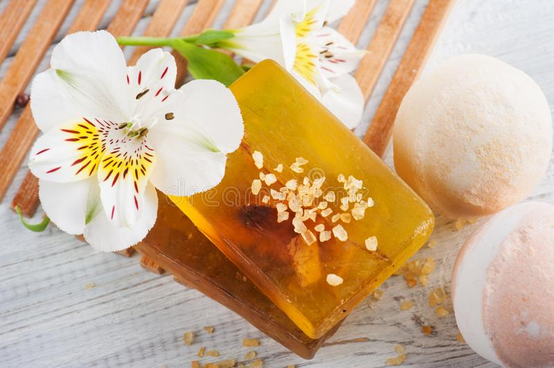 SPA composition with soap, bombs. SPA composition with bath bombs, soap, flower. White wooden background stock image