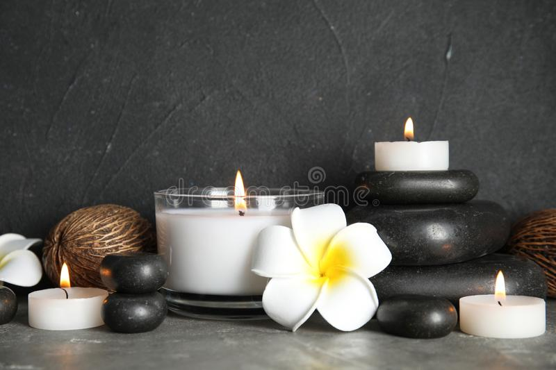 Spa composition with stones and candles. On table royalty free stock image