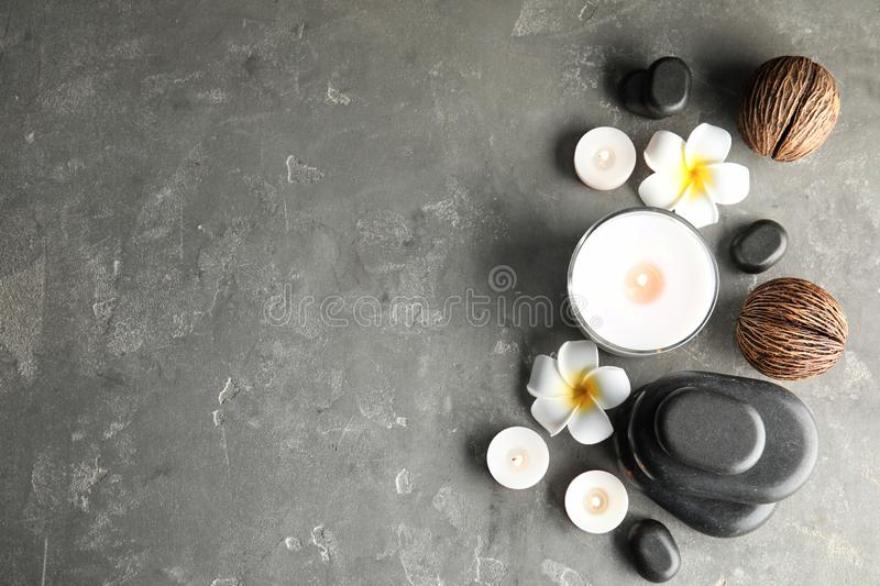 Spa composition with stones and candles on table. Flat lay. Space for text stock image