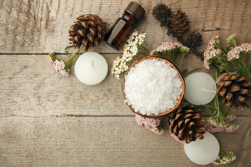 Spa composition on wooden table. Natural aroma oil, sea salt on rustic wooden background. Healthy skin care. SPA concept. Top view. With space for text royalty free stock photo