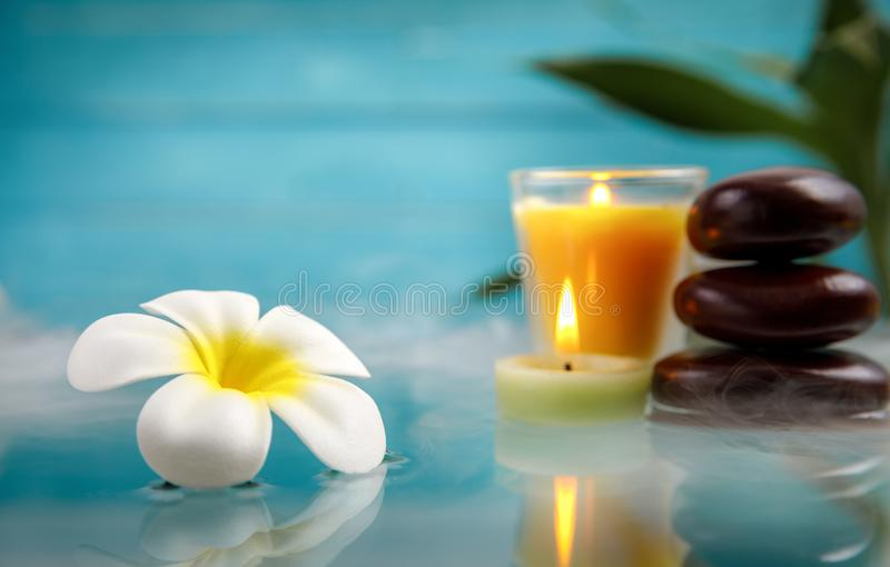 Spa concept with candle, stone, flower and bamboo stock photography