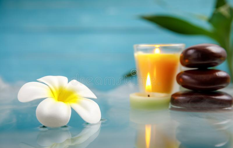 Spa concept with candle, stone, flower and bamboo. Relaxation stock image