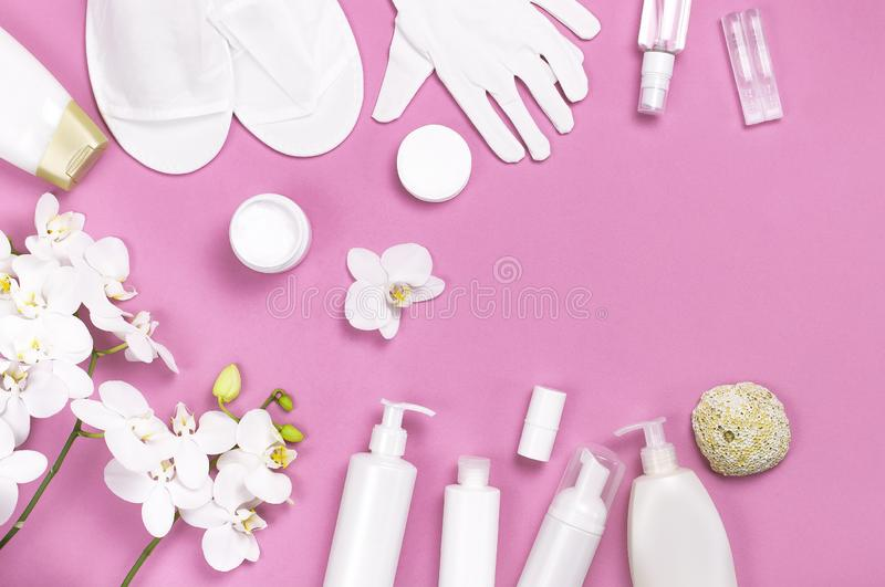 Spa concept cosmetology medicine plastic surgery branding mock-up. White cosmetic bottle gloves slippers hygiene items gasket. Tampon cotton pads injections royalty free stock image