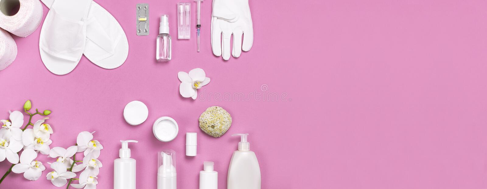 Spa concept cosmetology medicine plastic surgery branding mock-up. White cosmetic bottle gloves slippers hygiene items gasket. Tampon cotton pads injections stock photos