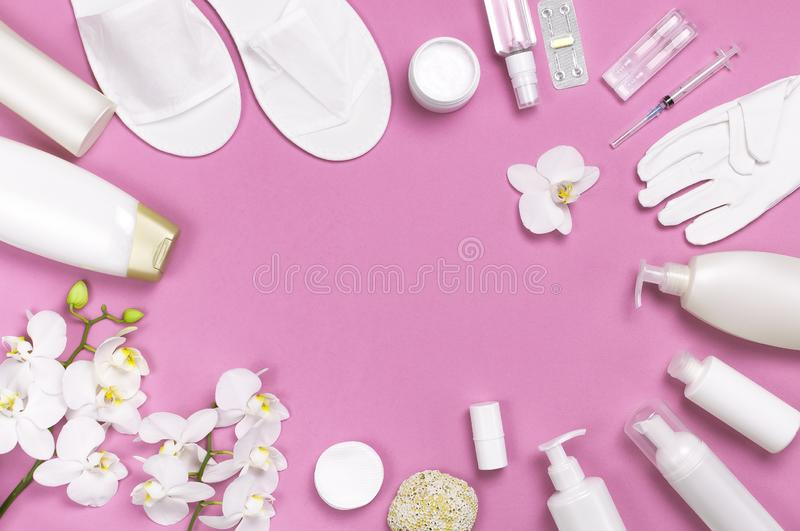 Spa concept cosmetology medicine plastic surgery branding mock-up. White cosmetic bottle gloves slippers hygiene items gasket. Tampon cotton pads injections stock photography