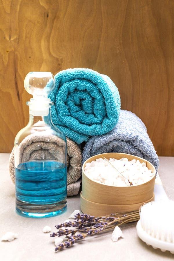Spa concept, natural ingredients. Bath towels, sea salt with lavender, shower gel, brush stock images