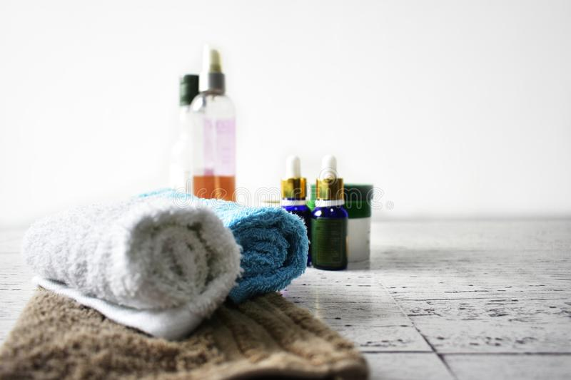 Spa concept towels oils body scrub pamper beauty wellness hygiene. Spa concept with towels, oils, body scrub on rustic wooden surface. Ideal for pamper, beauty stock images