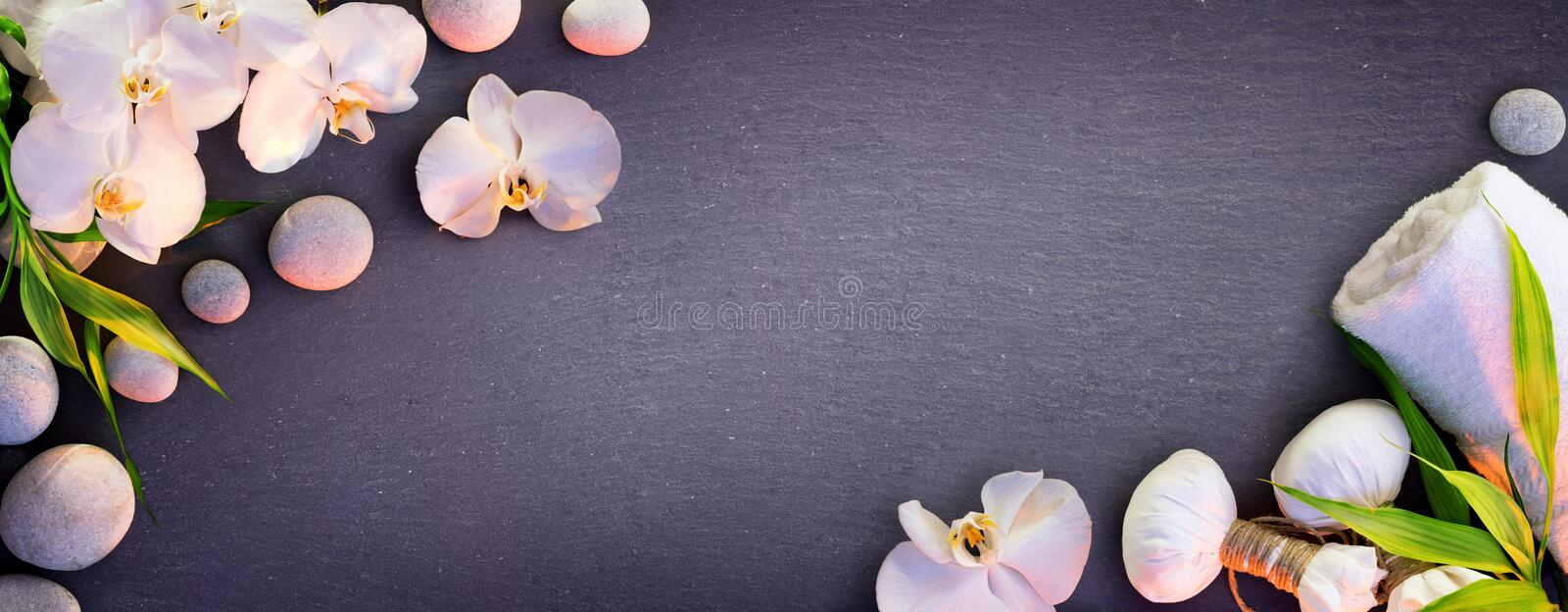 Spa Concept - White Orchid And Massage Stones royalty free stock photography