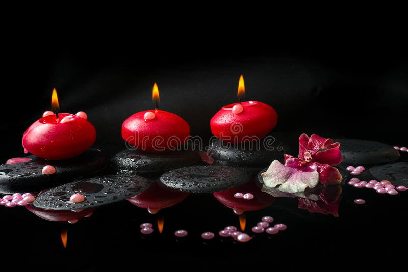 Spa concept of white and red orchid (cambria), three red candles stock photos