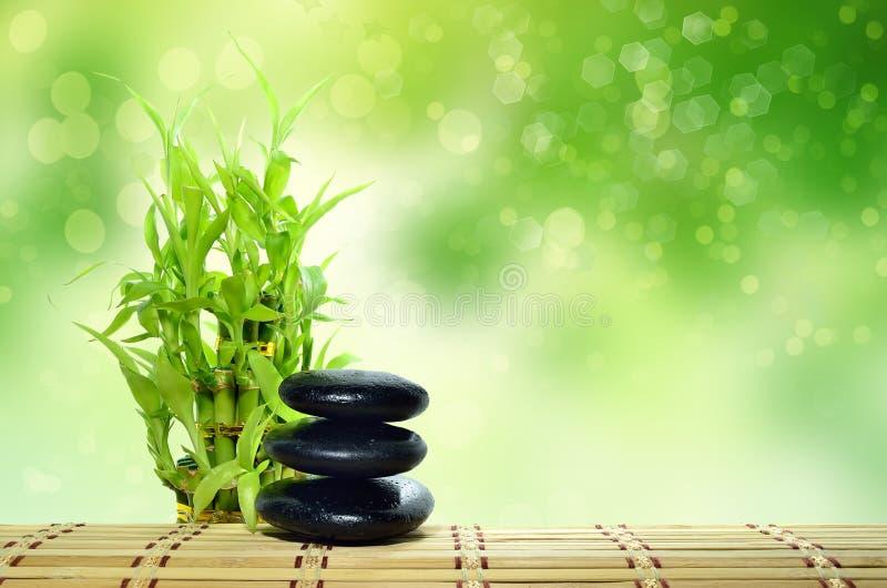 Spa concept zen. Basalt stones with bamboo stock photography