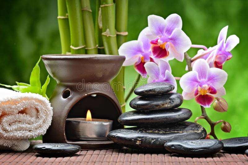 Spa concept. With zen basalt stones and orchid royalty free stock image