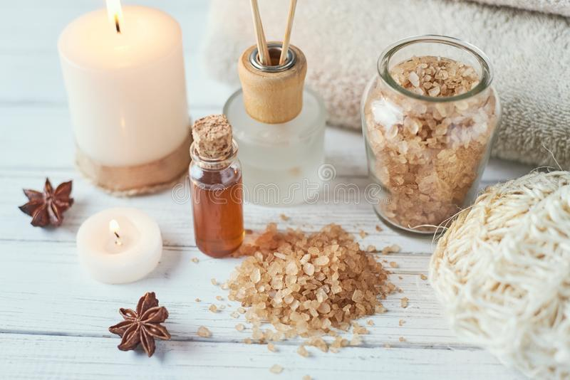 Spa and cosmetic treatment composition. Burning candle, sea salt and massage oil royalty free stock images