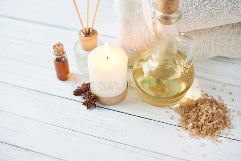 Spa and cosmetic treatment composition. Burning candle, sea salt and massage oil stock photos
