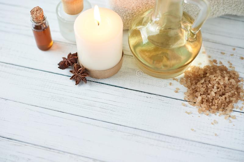 Spa and cosmetic treatment composition. Burning candle, sea salt and massage oil stock images