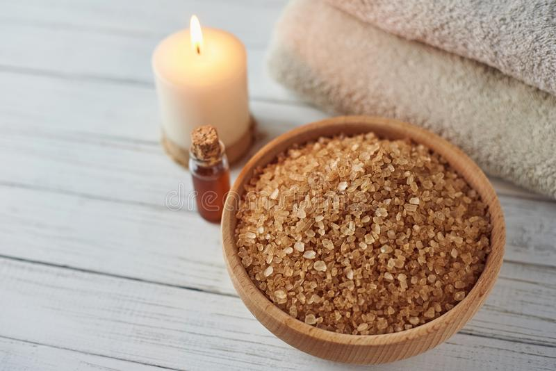 Spa and cosmetic treatment composition. Burning candle, sea salt and massage oil with copy space royalty free stock images
