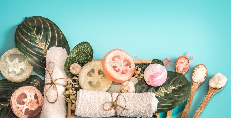 Spa cosmetics, composition on a blue background. Organic Spa cosmetics, composition with soap and Spa care items on blue background with tropical leaf, Spa and royalty free stock photography