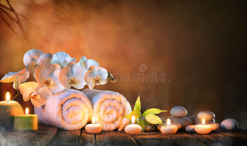 Spa - Couple Towels With Candles And Orchid royalty free stock image