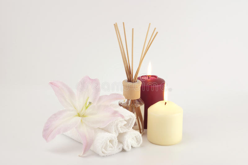 Spa decoration with candles, towels and aromatherapy oil bottle royalty free stock photos