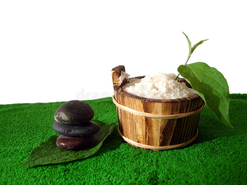 Spa essential. (pyramid of stones and washtub with bath salt stock photos