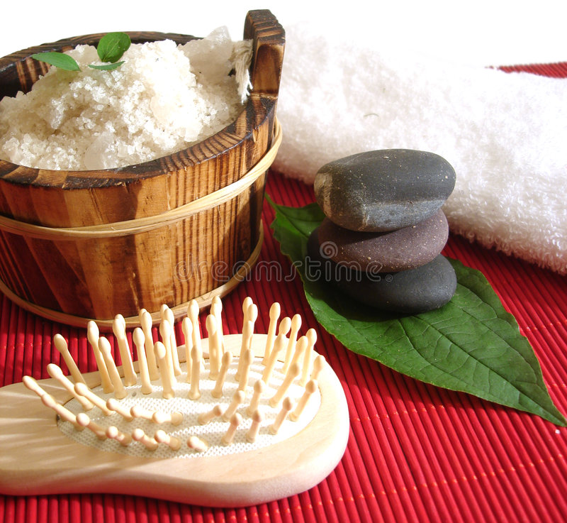 Spa essential. (pyramid of stones; brush and washtub with bath salt royalty free stock photography