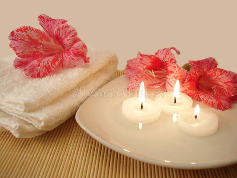 Spa essential. (towel, flowers and candles stock images