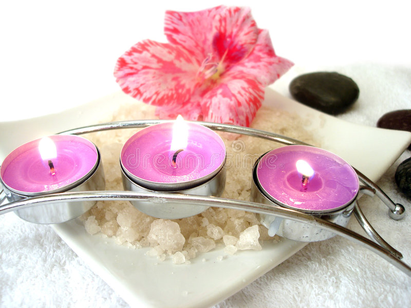 Spa essential. (candles, salt, towel, flower and stones stock image