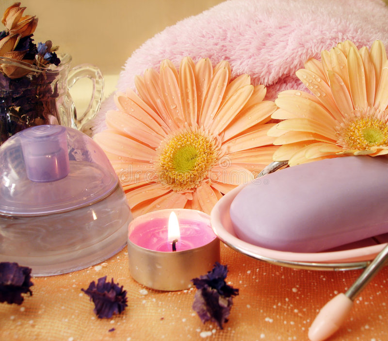 Spa essential. Soap, towel, candle and perfume royalty free stock image
