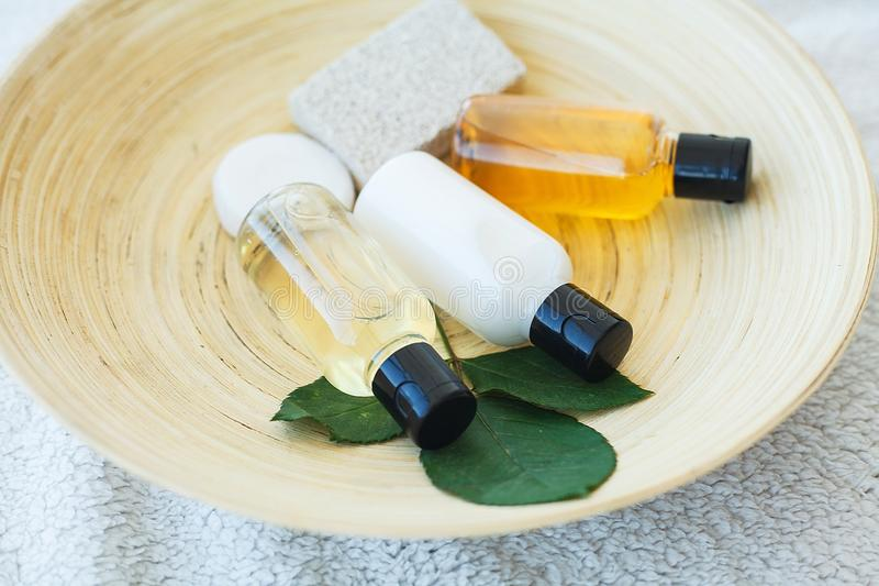 Spa essentials including natural oils, salt, soap. Organic cosmetics concept.  royalty free stock image