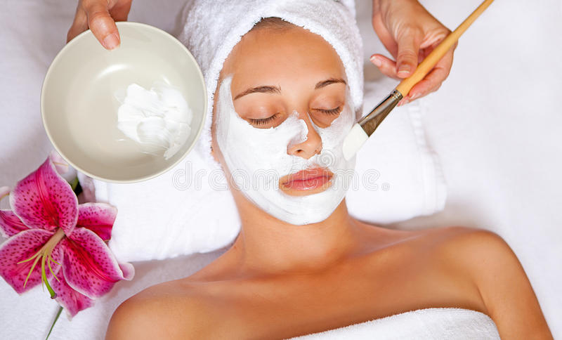 Spa face mask. Woman at spa having relaxing face mask
