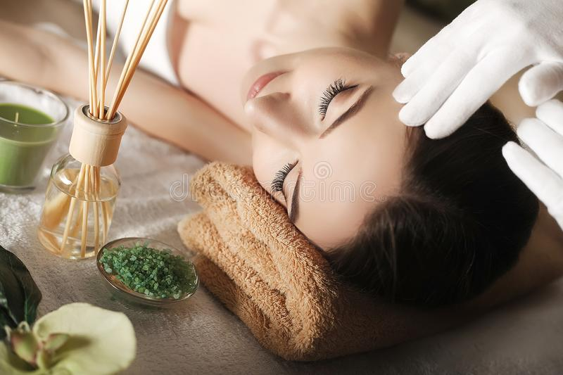 Spa. Face massage. Spa skin and body care. Close-up of young woman getting spa massage treatment at beauty spa salon. Facial beau stock images
