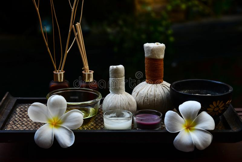 Spa feet and hand thai massage compress balls, herbal ball on the wooden with treatments spa , royalty free stock photography