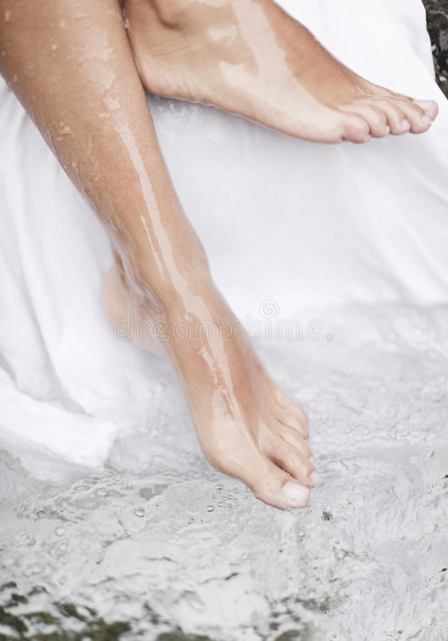 Spa - Female leg massage with aerated water. Spa - Female legs massage with aerated water stock photo