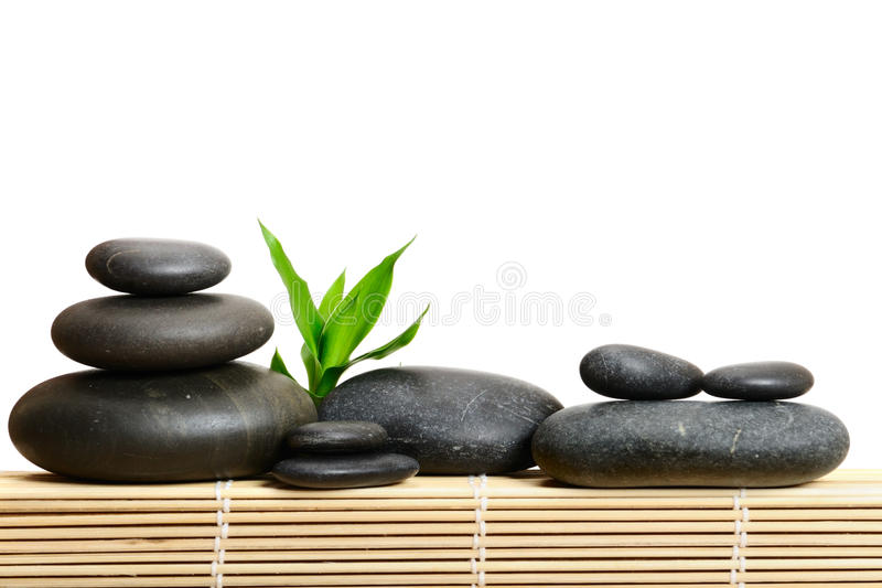 Spa frame. Zen stones and bamboo on the white background royalty free stock photo