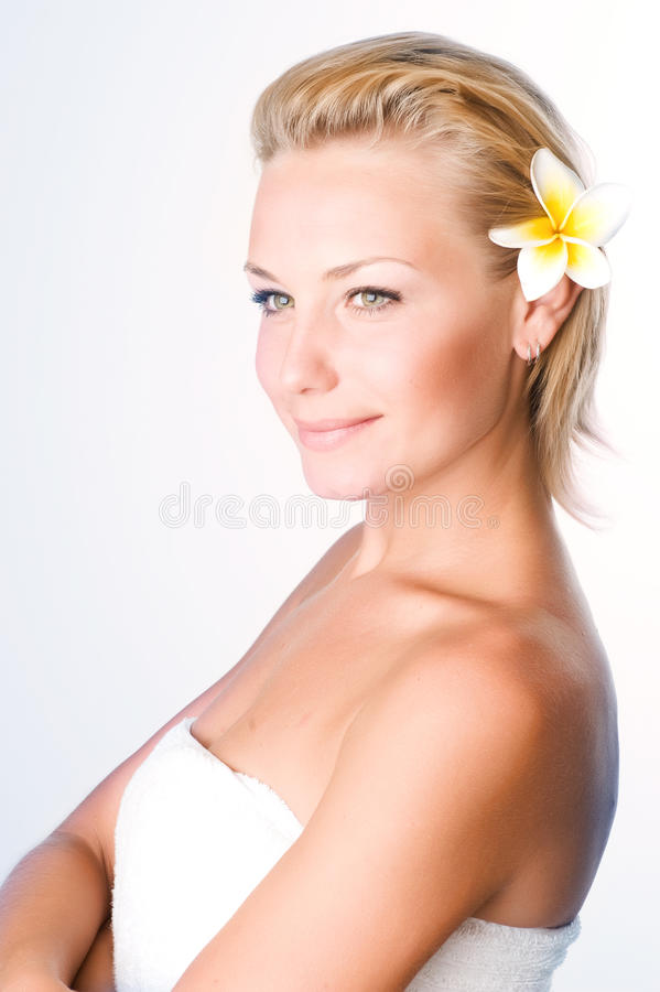 Spa Girl. Beautiful Healthy Young Woman with frangipani flower stock photography