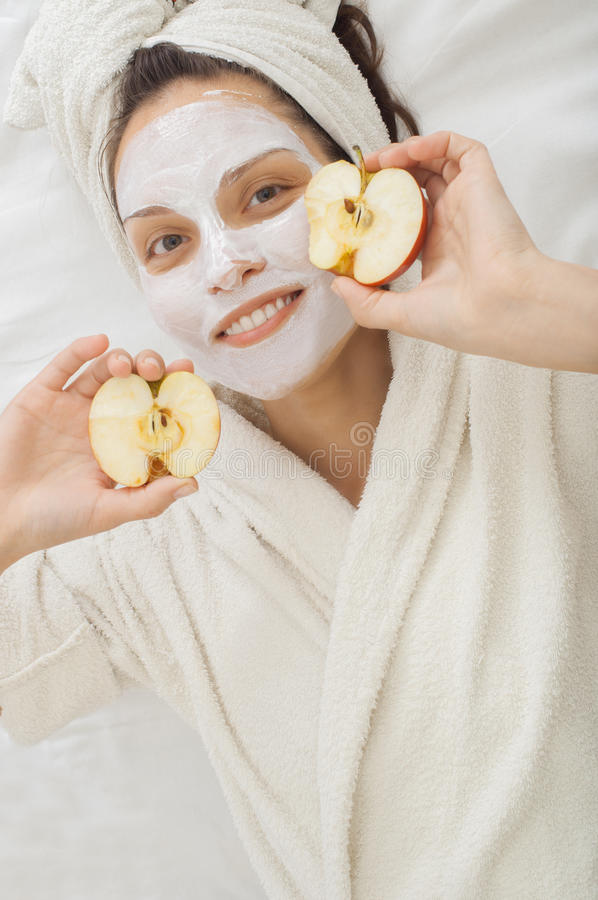 Spa girl with Facial krem Mask with apple royalty free stock image