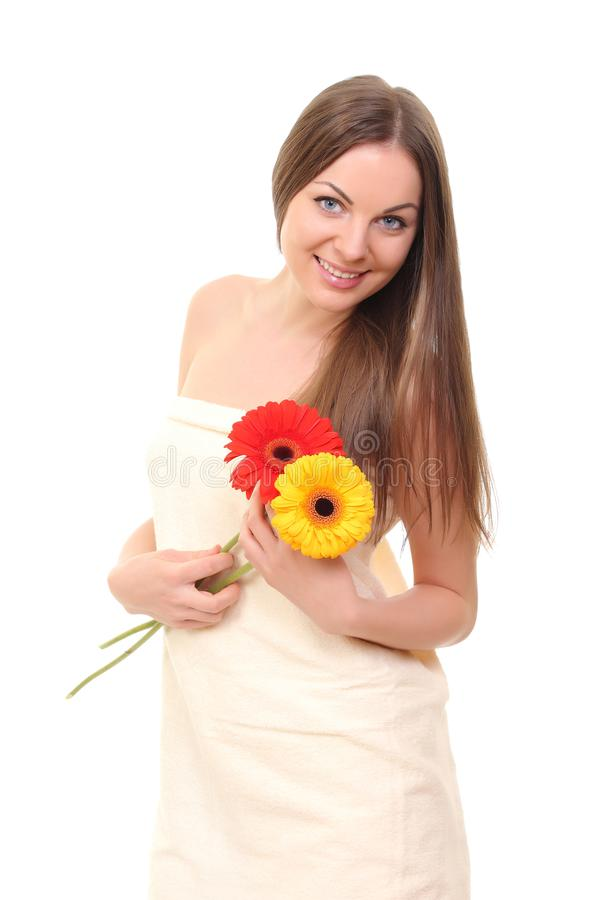 spa girl with flowers stock photography