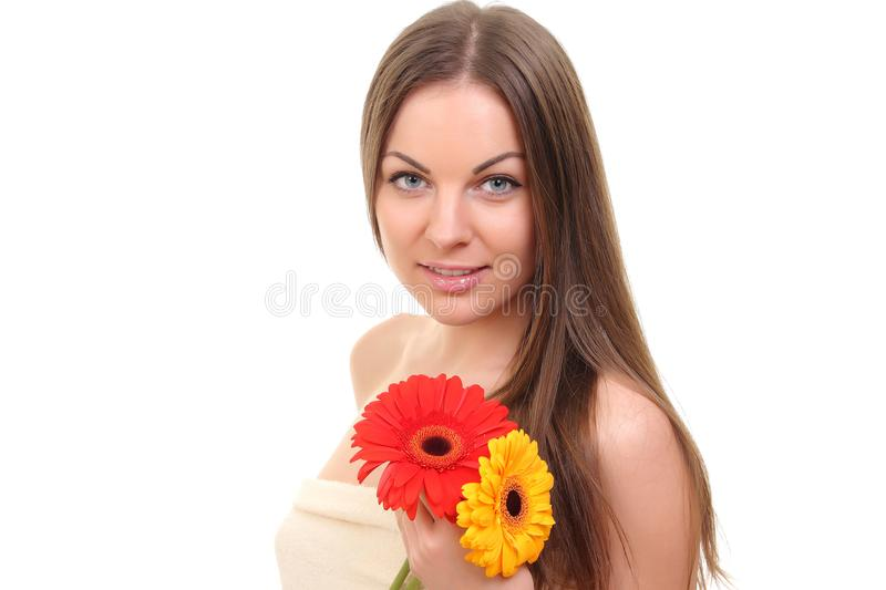 spa girl with flowers royalty free stock images