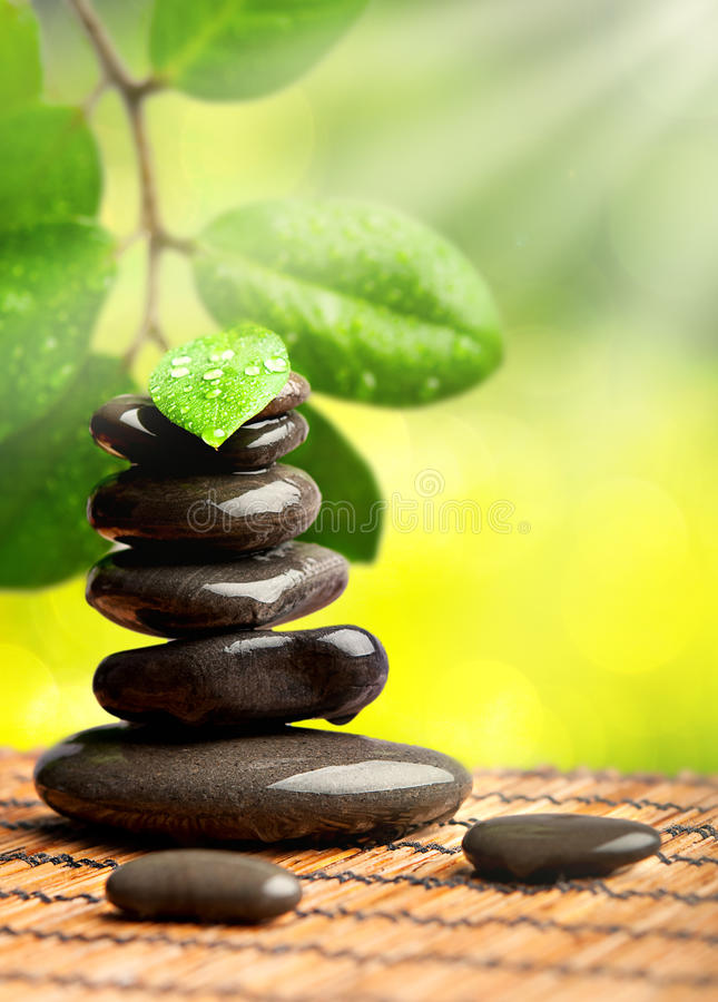 Spa green background. stones with water drops stock photo
